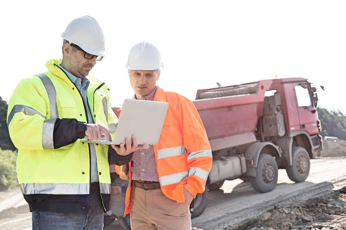 contractors using a laptop